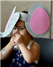 Young girl completes elephant hat craft