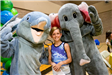 Young girl with animal mascots