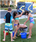 Kids playing with water buckets
